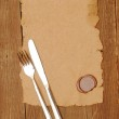 Knife and fork on old paper. space for the text — Stock Photo