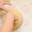 Child's hands kneading dough — Stock Photo