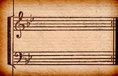 背景に使用する、古い紙のシート上の音楽ノート — ストック写真