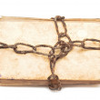 Old book with chain on white background - Zdjęcie stockowe