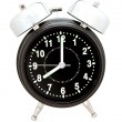 Black alarm clock isolated on white — Lizenzfreies Foto
