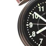 The alarm clock on white background — Stock Photo