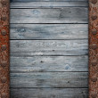 Old wooden wall in rusty metal frame texture — Stock Photo