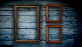 Wooden photo frame on old wooden wall — Stock Photo