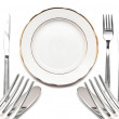 Knife, white plate and fork on a white background — Stock Photo