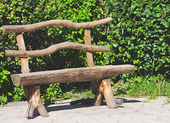 Wood bench in a park — Stock Photo