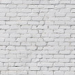 A white brick wall - Stock Photo