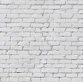 Een witte bakstenen muur — Stockfoto