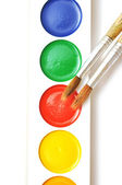 Closeup water color paints and brushes — Stock fotografie