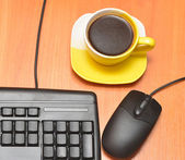 Computer mouse, black keyboard and coffee cup — Stock Photo