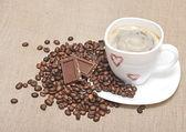 Mug coffee and coffee beans — Stock Photo
