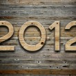 """2012"" number on old wood background — Stock Photo"