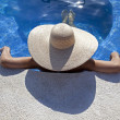Relaxed woman in the pool - Stock Photo