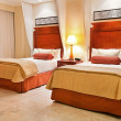 Beds of hotel room - Stock Photo