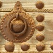 Decoration on old wooden door - Stock Photo