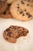 Bite taken chocolate cookie — Stock Photo