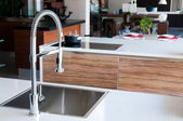 Shiny stainless steel faucet — Photo