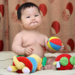 Child Asian. With toys. — Stock Photo #5769030