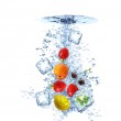 Fruit water splash with ice cubes isolated — Stock Photo #5962351