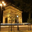 Beautiful night view of the Arc de Triomphe, Paris, France - Stock Photo