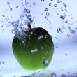 Fresh green apple with water splash - Stock Photo