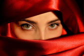 A portrait of a young arabic woman in red satin — Stock Photo