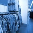 Stock Photo: Interior of fashion boutique in modern shopping mall