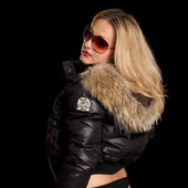 Beautiful girl in a jacket with fur hood — Stock Photo