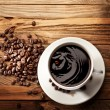 Drop falling into a cup of coffee. — Stock Photo