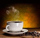 Cup of coffee with coffee beans — Stok fotoğraf