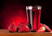 Glass with strawberry juice and berries. — Stock Photo