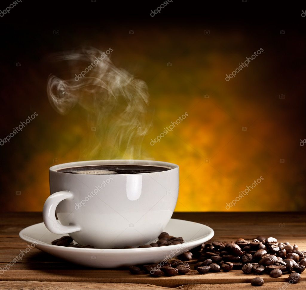 Cup of coffee with coffee beans on a beautiful brown background. — Stock Photo #5627541