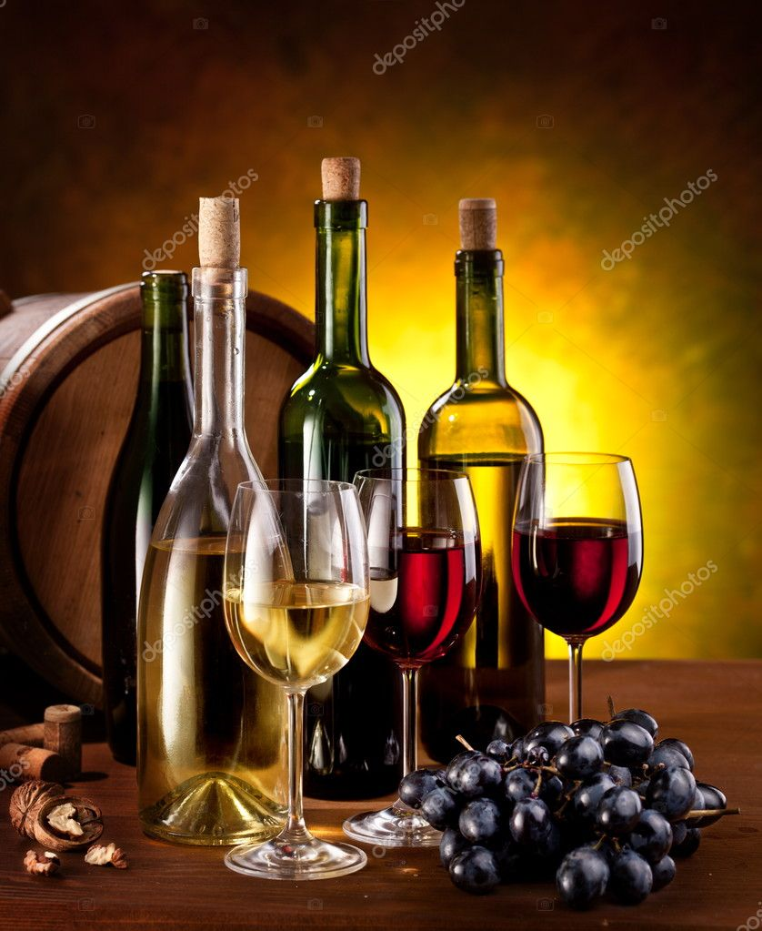 Still life with wine bottles, glasses and oak barrels.  Stock Photo #5628180