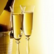 Champagne bottle and glasses — Stock Photo
