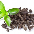 Heap of dry tea with green tea leaves. — Stockfoto
