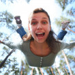 Woman falls from above the pine forest directly at you. - Foto de Stock