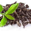 Heap of dry tea with green tea leaves. - Stockfoto