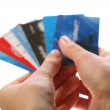 Cards in woman hands — Stock Photo