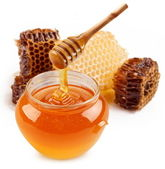 Pot of honey and wooden stick. — Stock Photo