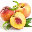 ripe peach fruit with leaves and slises — Stock Photo