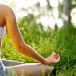 Practicing of yoga outdoors. — Foto de Stock