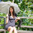Stock Photo: Beautiful sexy girl under the umbrella