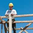 Construction worker on scaffold busy with formwork preparation — Stock Photo #5600180