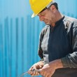 Construction worker cutting wire with pair of pliers — Stock Photo #5613752