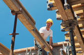 Construction worker placing formwork beams — Stock Photo