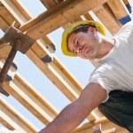 Construction worker under formwork girders — Stock Photo