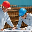 Stock Photo: Young engineer and senior foreman