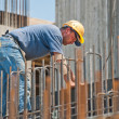 Construction worker busy with forwork frames - Foto Stock