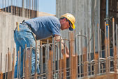 Construction worker busy with forwork frames — Stock Photo