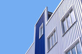 White and blue office building with windows — Stock Photo